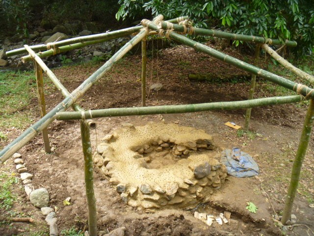 base of the cob oven with reciprical roof